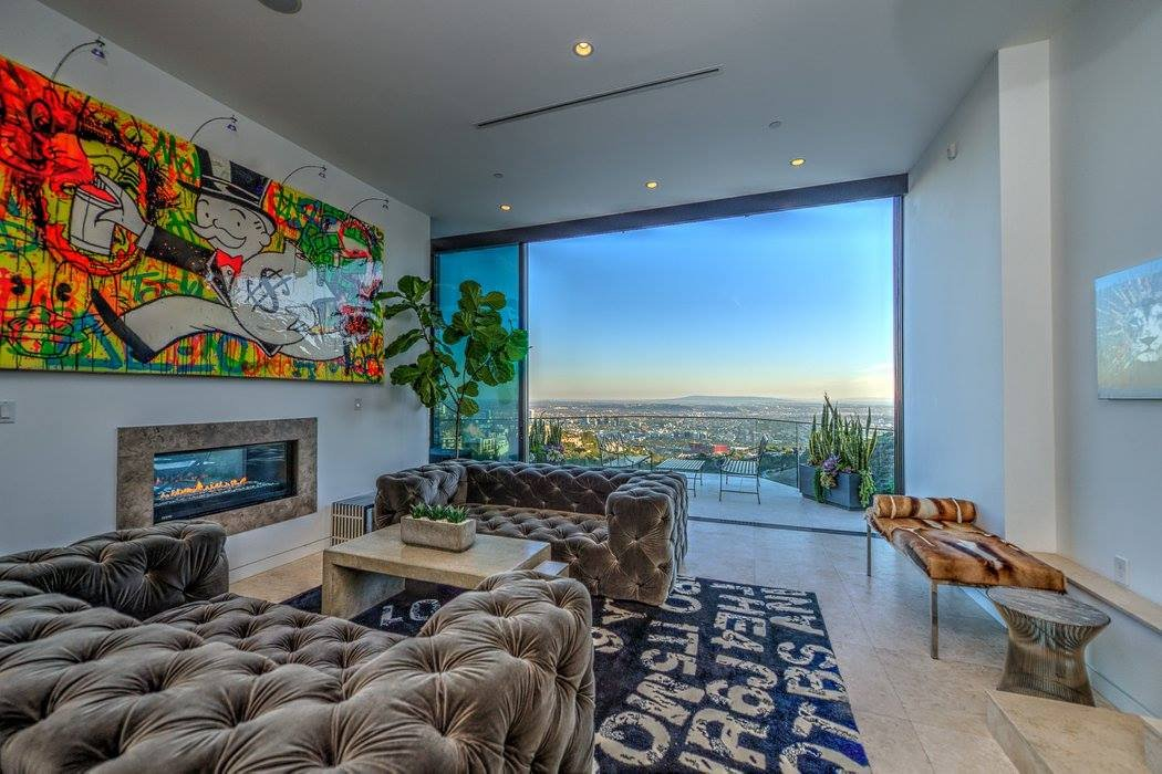 and-this-second-lavishly-appointed-living-room-which-also-has-alec-monopoly-art-in-it